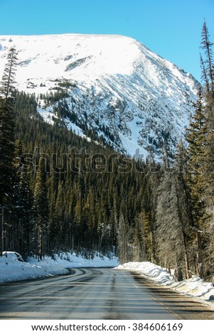 Beautiful winter landscape with snow covered trees road and mountain at Colorado, USA
