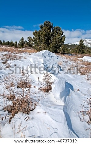 Beautiful winter landscape, with snow patterns, and blue sky - stock photo