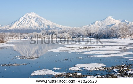 beautiful winter landscape with volcano and lake