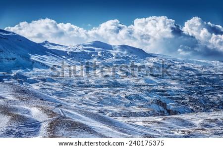 Beautiful winter mountains, majestic snowy landscape, ski resort, Christmas greeting card, beauty of wintertime nature - stock photo