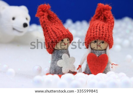 Beautiful winter scene with cute puppet and polar bear