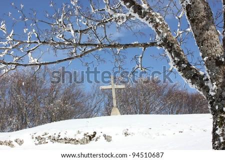 Beautiful winter scenery, religious cross in Plateau de Sornin, Vercors massif, near Grenoble, France - stock photo