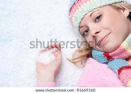 Beautiful winter snow woman playing - stock photo