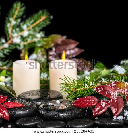 beautiful winter spa concept of zen basalt stones with drops, lilac candles, beads and evergreen branches, closeup   - stock photo