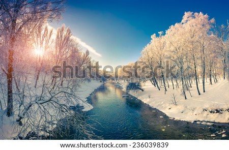 Beautiful winter sunrise in the city park. Retro style. - stock photo