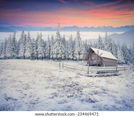 Beautiful winter sunrise in the mountain farm. First frost in December. - stock photo