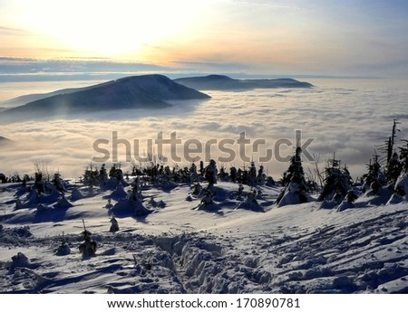 Beautiful winter sunset in mountains in Czech republic - stock photo
