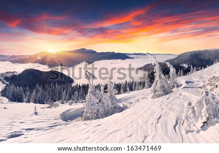 Beautiful winter sunset in the mountains - stock photo