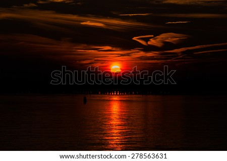 Beautiful winter sunset over the Isle of Wight Bay, from Ocean City, Maryland. - stock photo