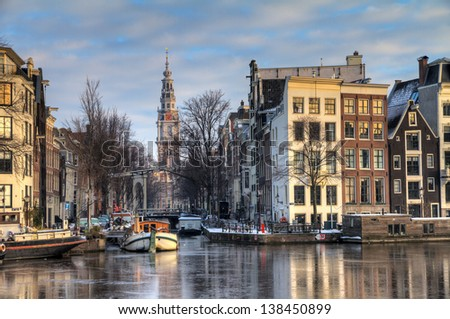 Beautiful winter view on the Groenburgwal and the Southern church in Amsterdam, the Netherlands. HDR - stock photo