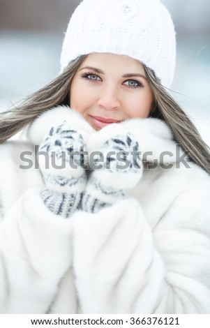 Beautiful winter woman portrait, happy girl in wintertime outdoor, smiling young woman in winter woolen accessories. Attractive female outdoors in winter park, series, soft filter instagram like