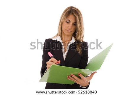Beautiful with a green folder writing something - stock photo