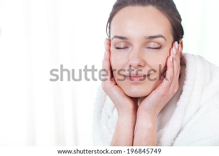 Beautiful woman after face massage in spa - stock photo