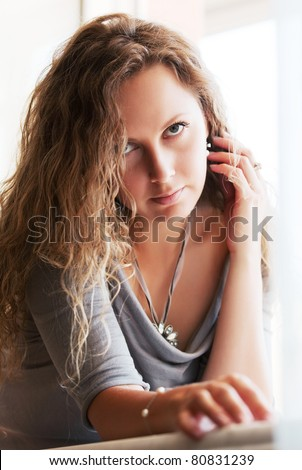 Beautiful woman against a window - stock photo