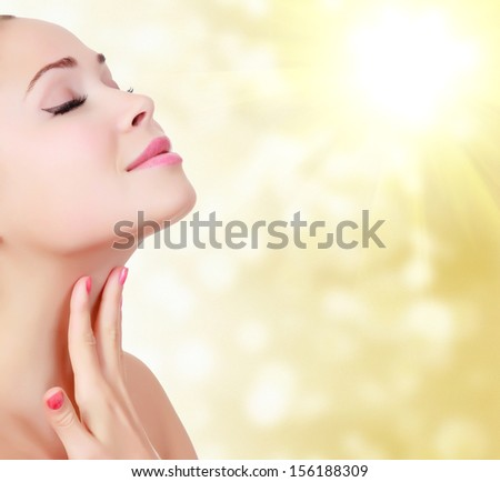 Beautiful woman against an abstract blurred background  - stock photo