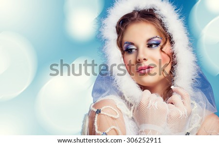 beautiful woman against blue background, Christmas topic - stock photo