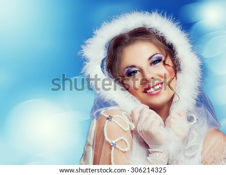beautiful woman against colorful blue background, Christmas topic - stock photo
