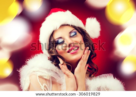 beautiful woman against colorful red background, Christmas topic - stock photo