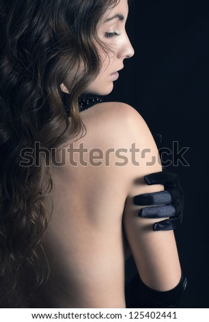 beautiful woman  against dark background - stock photo