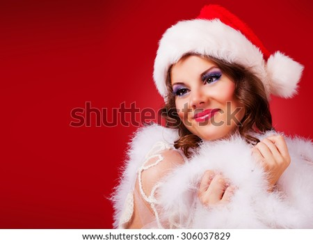 beautiful woman against red background, Christmas topic - stock photo