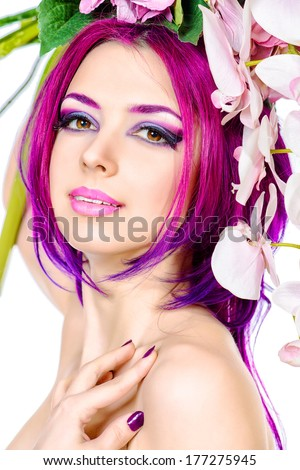 Beautiful woman among the flowers. Spring. Summer. Skin care. Hair coloring. Isolated over white.