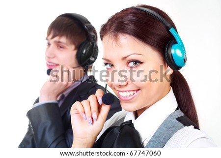 beautiful woman and a young man working in the call-center (focus on the woman) - stock photo