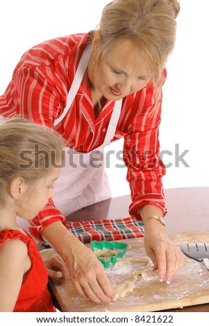 beautiful woman and child baking cookies - stock photo
