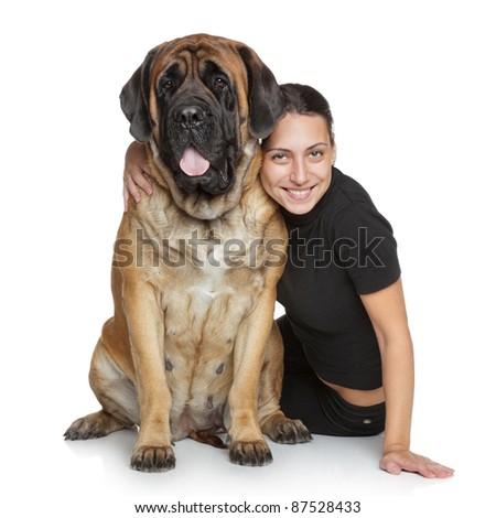 Beautiful woman and English mastiff dog on white background - stock photo