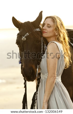 beautiful woman and her arabian horse - stock photo