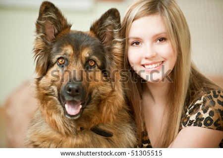 Beautiful woman and its sheep-dog close up. - stock photo