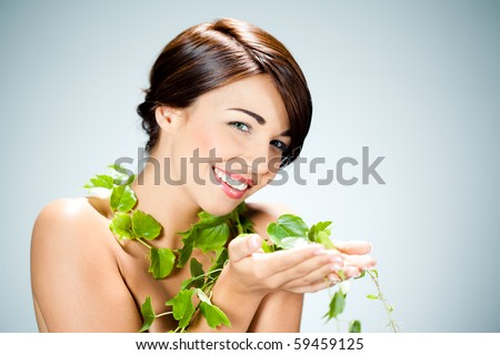 beautiful woman and ivy leaves - stock photo