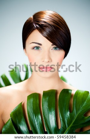 beautiful woman and leaves - stock photo