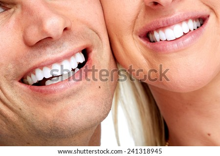 Beautiful woman and man smile. Dental health background. - stock photo