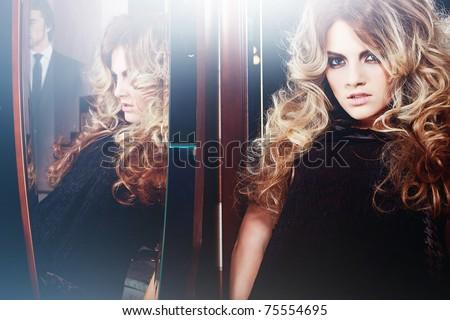 beautiful woman and mirror - stock photo