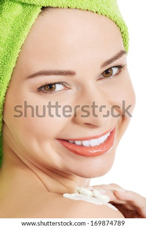 Beautiful woman applying body lotion on arm. Spa concept. - stock photo