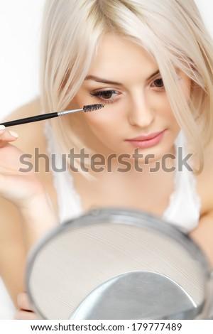 Beautiful Woman applying Mascara on Eyelashes. Eye Makeup - stock photo