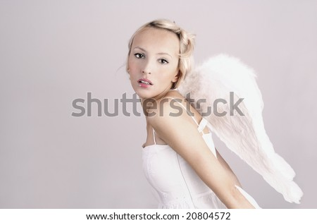beautiful woman as angel - stock photo