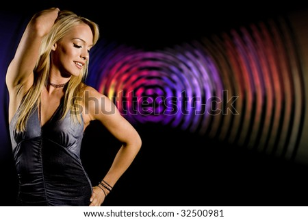 Beautiful woman at a night club - stock photo