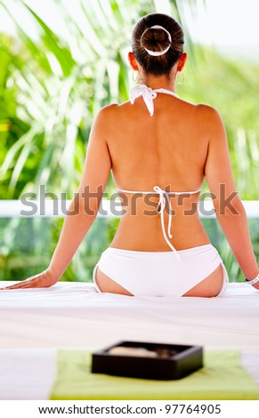 Beautiful woman at a spa ready for a back massage - stock photo