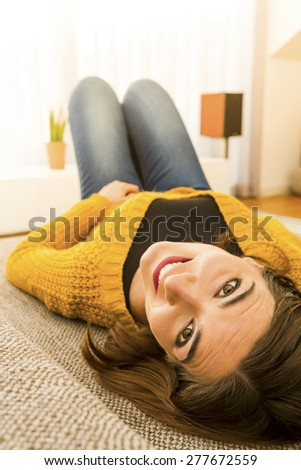Beautiful woman at home relaxing in the sofa - stock photo