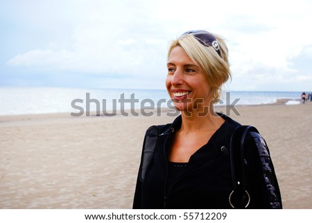 Beautiful woman at the beach - stock photo