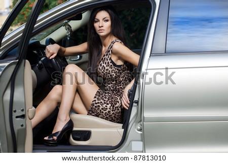 Beautiful woman at the car - stock photo