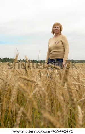 Beautiful woman at the field