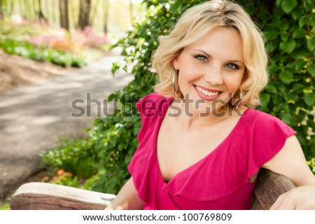 Beautiful woman at the park in spring - stock photo
