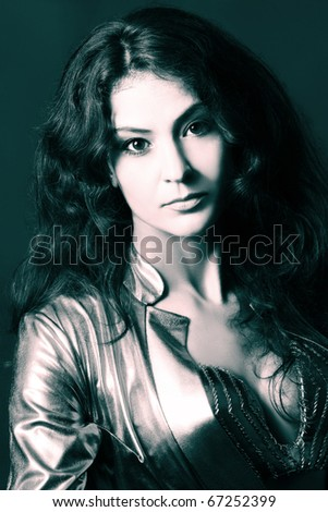 Beautiful woman. Attractive looking brunette. Black and white toned portrait. - stock photo