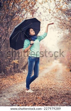 beautiful woman autumn portrait black umbrella  - stock photo