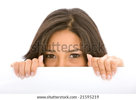Beautiful woman behind a banner add isolated over a white background