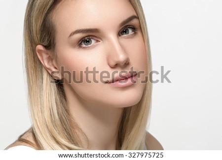 Beautiful woman blonde hair portrait close up studio on white  - stock photo