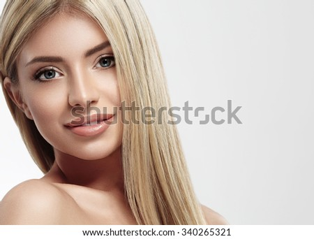Beautiful woman blonde hair portrait close up studio on white long hair  - stock photo