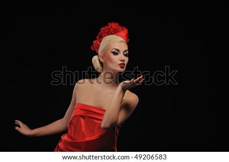Beautiful woman blowing a kiss - stock photo